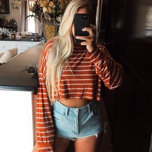 Orange and white striped long sleeve crop top